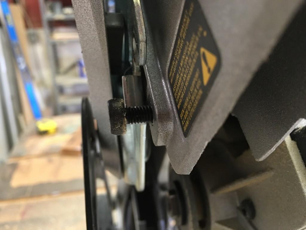 Loosened lower guard screw